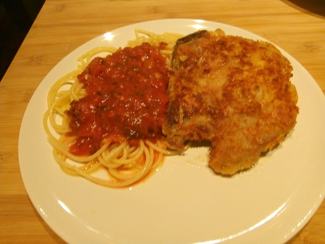 Italiaanse gepaneerde karbonade met spaghetti